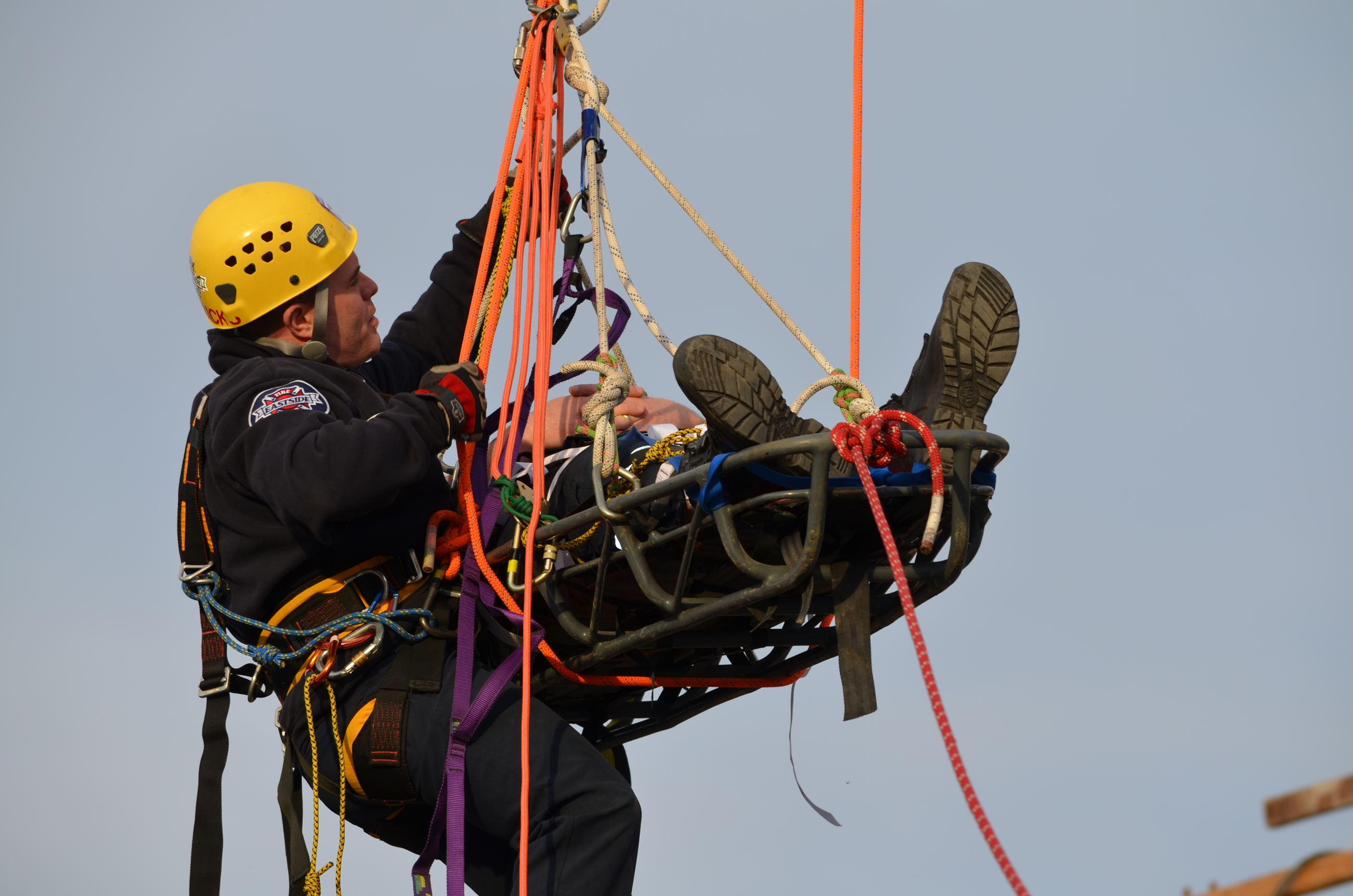 firefighters performing ropes rescue